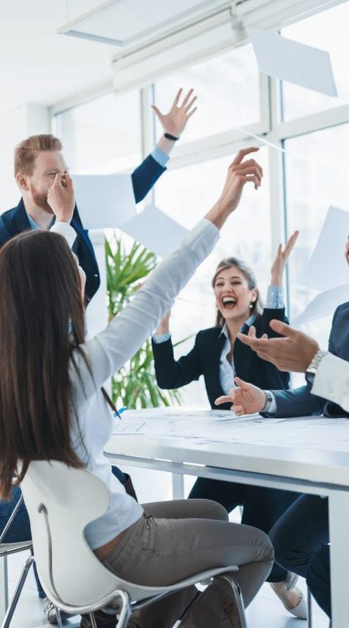 team meeting celebrating SEO results success